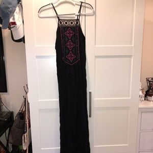 Black maxi dress with embroidered pattern